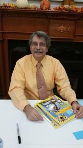 photo of John Micklos at a book signing