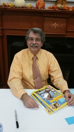 photo of John Micklos at a book signing