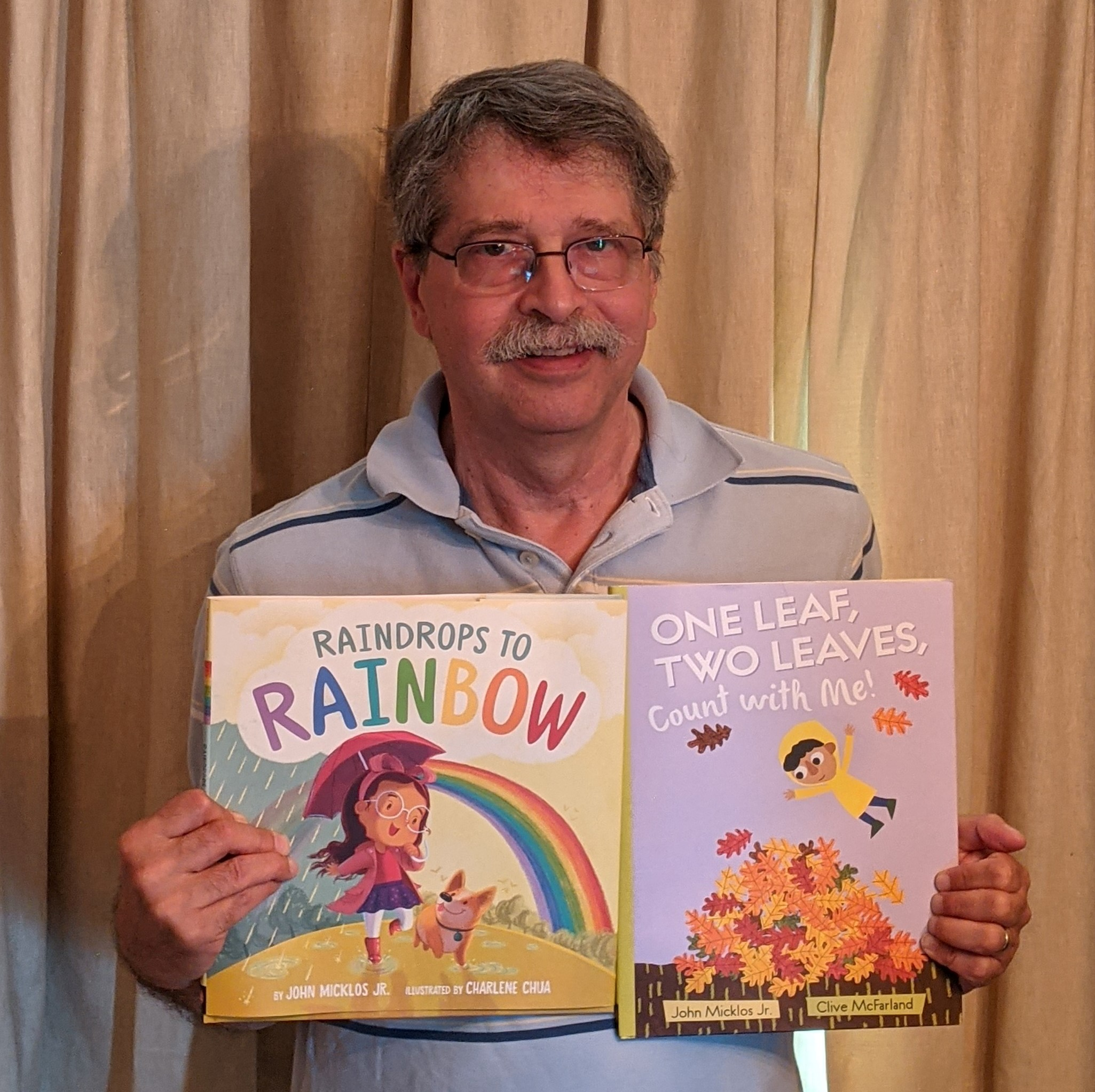 john-micklos-with-picture-books